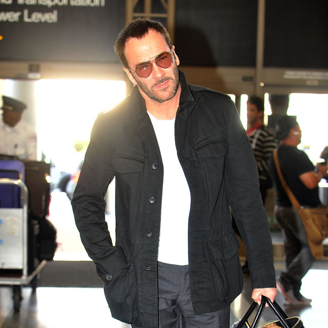 Tom Ford and his husband Richard Buckley head through LAX with their son Alexander to catch a flight to London. Pictured: Tom Ford Ref: SPL724304 220314 Picture by: Splash News Splash News and Pictures Los Angeles:310-821-2666 New York: 212-619-2666 London: 870-934-2666 photodesk@splashnews.com